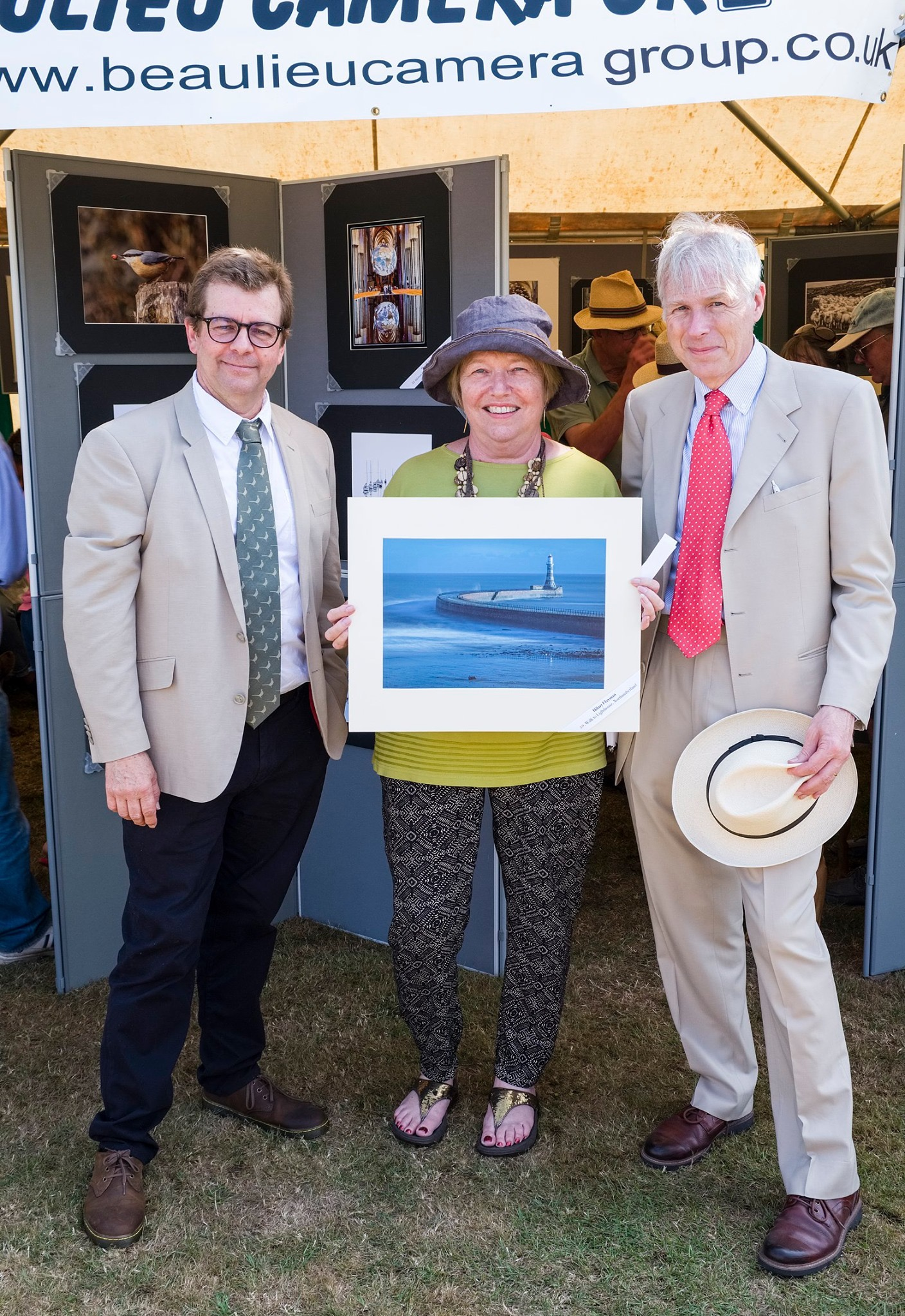"Hilary Flaxman with her print ""Walk to the Lighthouse, Northumberland"""